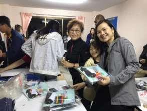 Team packing gift back for children