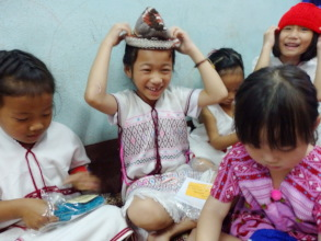 Karen Tribe Kids in Chiangrai Try out Beanies