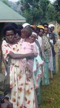 Pregnant Women and Mothers Receiving Nets