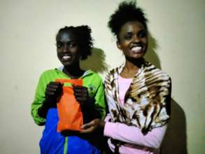 Beneficiaries pose with a set of pads in Aug 2021