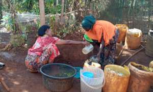 Community member collecting water