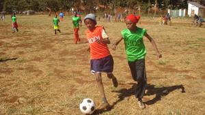 Girls tackling the ball
