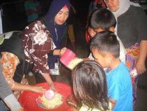 Children receiving hot delicious food