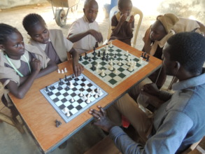Children being taught chess