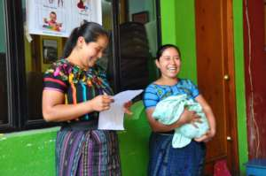 Two mothers participate in the workshop