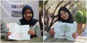 Proud Dar Taliba students show their drawings