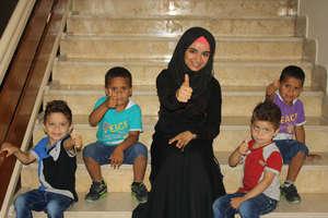 Volunteer Asmaa and the boys give a big thumbs up!