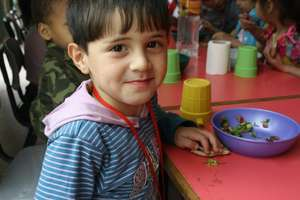 A Child in the Center Receives a Healthy Snack