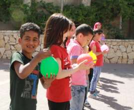 TYO student Yoseph holds his water balloon.
