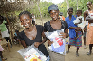 Women in Haiti receiving Safe Motherhood Kits