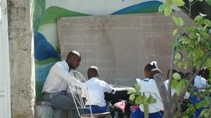 Children attending class in the open air