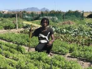 Young Farmer in his garden