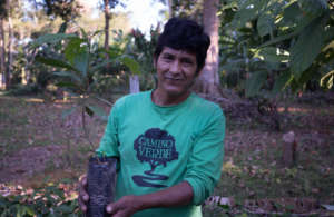 Juan with a seedling from our nursery
