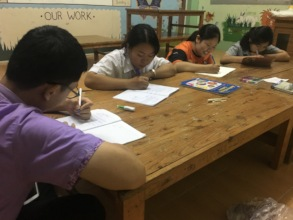 CLC Students Learn English During a Night Class