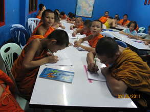 Novice monks from the local temple working hard!