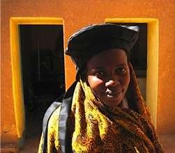 Aisha models a new hat prototype.