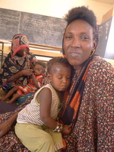 Halima Orte, Pres. of Barka Cooperative & her son