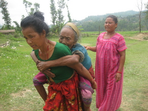 Patient carried to an Eye Camp