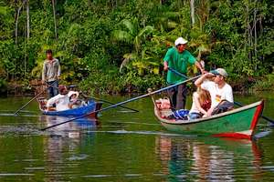 Guides take tourists on a river rour