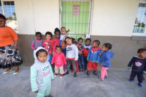 Students in front of Love to Langa Classroom
