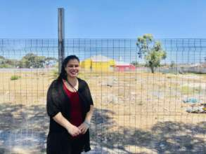 Nada in front of the land for our new Montessori