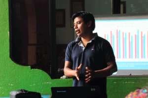 Tomas presents WASH results at an staff meeting