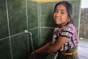 Washing up with rainwater at Patzilin Ab'aj