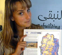 Morgan holding a map of West Bank Areas A, B, & C