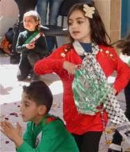 Al Aqaba's Kindergarteners performing on Land Day