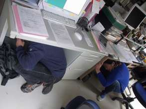 Seeking protection during earthquake simulation
