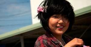 Smiling girl displaced by Japanese tsunami