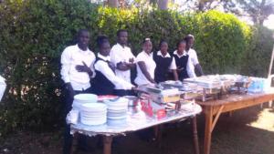 Sergoek - young caterers display goods