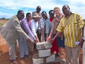 Rafiki Ya Maisha laying cornerstone