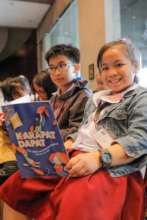 Young readers with their new books.