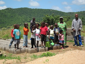 Students with building blocks for the new toilet.