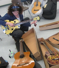 Alisa Peres tunes teachers' guitars in San Jose