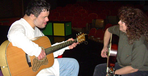 Robin and Michael play guitar