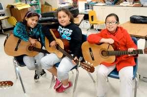 students play guitar during social studies