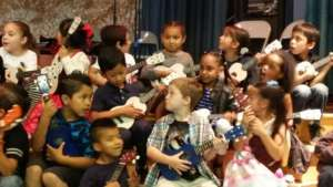 Kindergarteners strum, sing and learn!