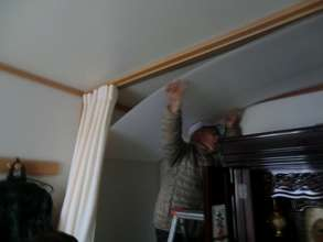 A resident, Mr. HATAKEYAMA working on ceiling