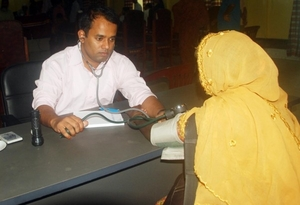 Doctor Examining a Diabetic Patient in Camp