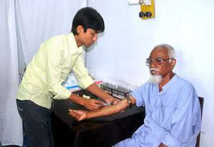 A Lab Technitian is taking blood for tests