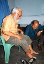 Doctor Examining the Feet of a Patient