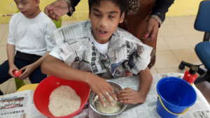 Daniel making raibow rice