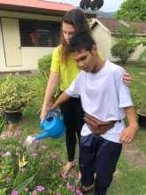 Daniel is watering the plants