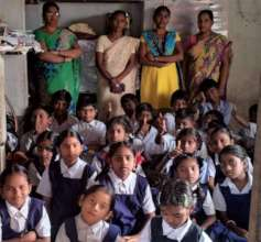 staff and children in classroom