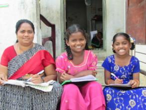 Teacher Sailaja with children
