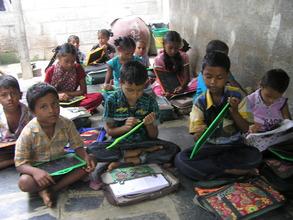 children in a small classroom