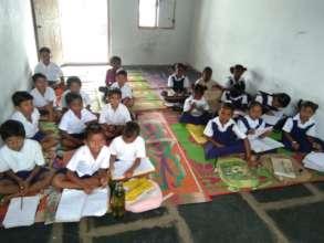 Classroom- children sitting on mats