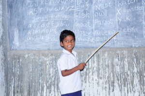in class repeating words with other children